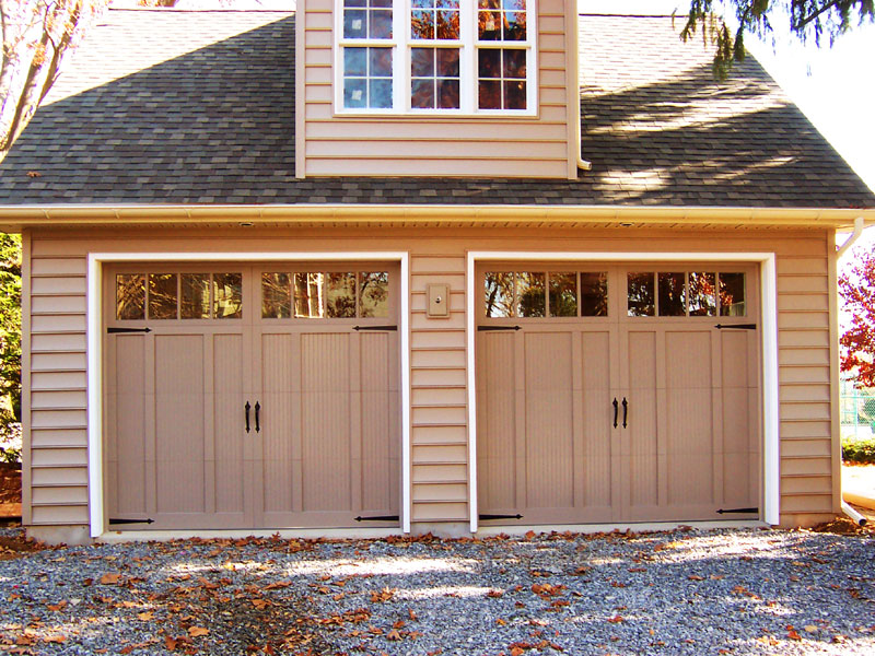 Steel carriage house overlay new holland garage door for Residential garage kits